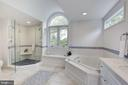 Owners' bath offers dual shower heads - 5508 DEVON RD, BETHESDA