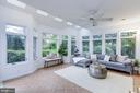 Sunroom overlooks blooming yard and private pool - 5508 DEVON RD, BETHESDA