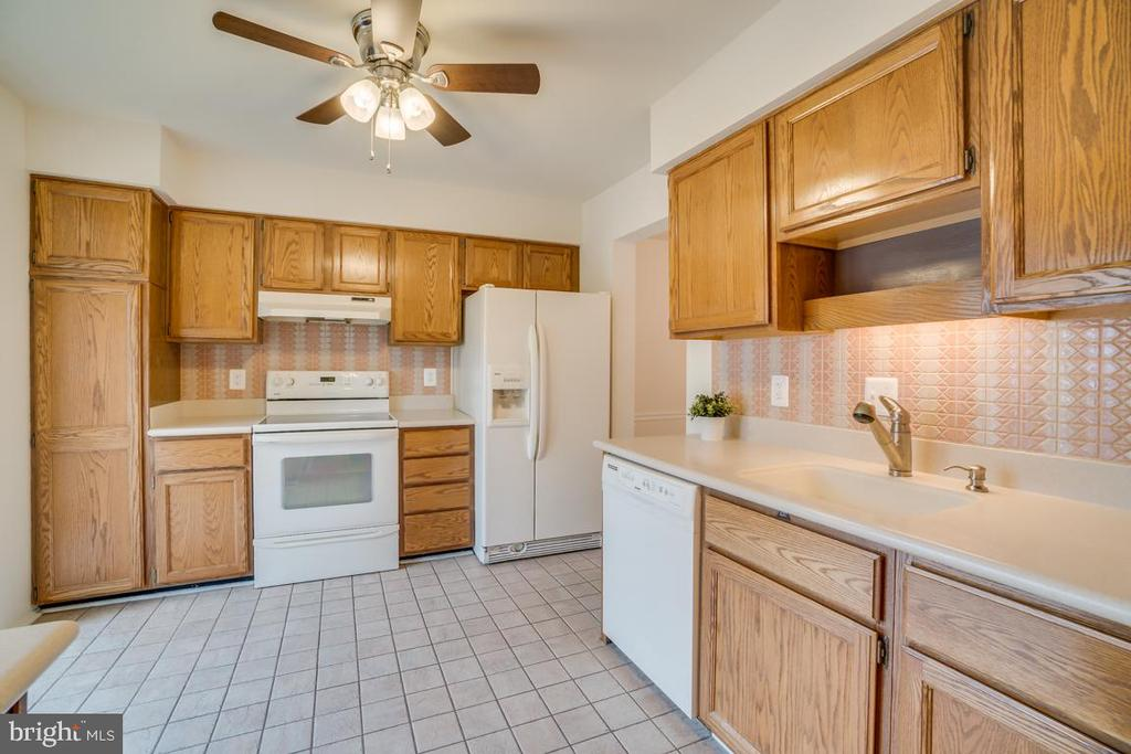 Kitchen is Loaded with Cabinets - 12090 WINONA DR, WOODBRIDGE