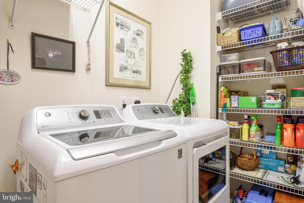 Full size laundry room with plenty of shelf space - 19355 CYPRESS RIDGE TER #416, LEESBURG