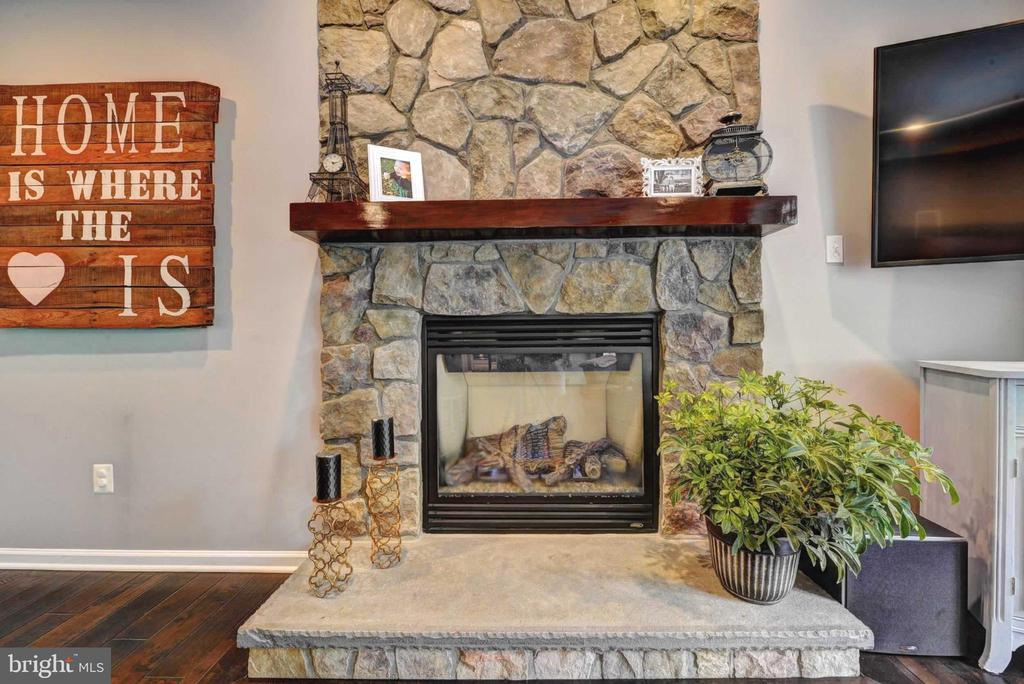 Gas stone  fireplace with wood mantle - 20305 MEDALIST DR, ASHBURN