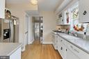 Kitchen with Corian counters & hardwood floors - 210 N EDISON ST, ARLINGTON