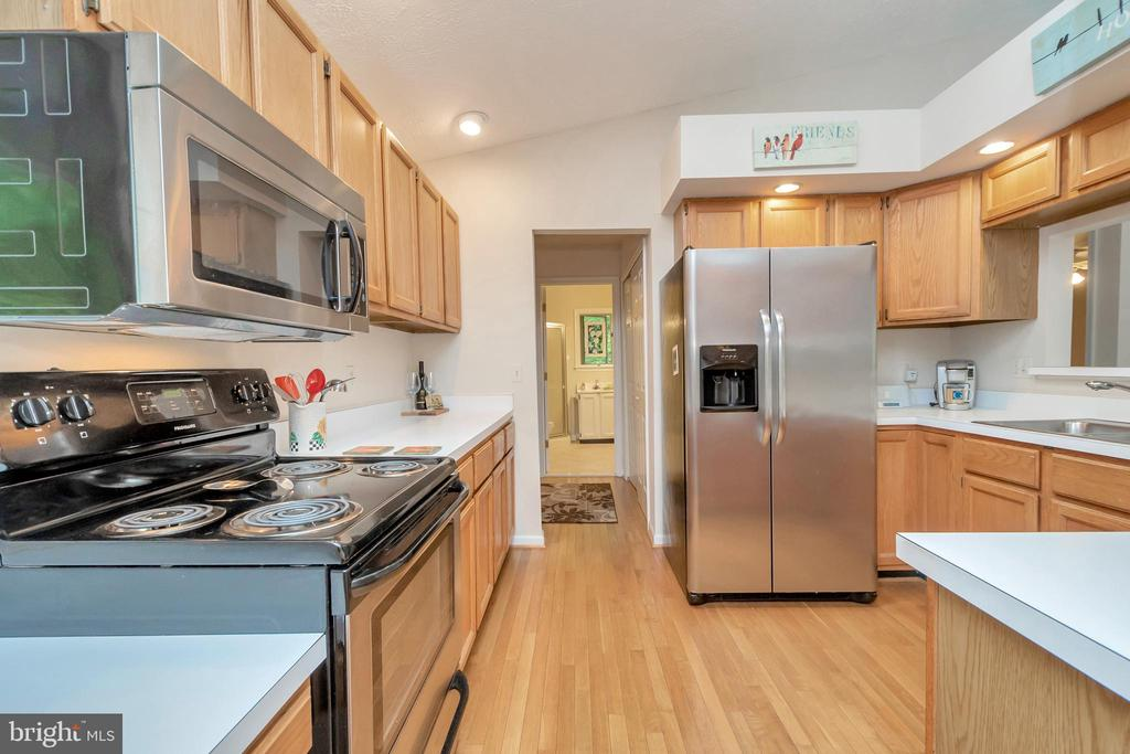 Kitchen with new stainless appliances - 107 GREEN ST, LOCUST GROVE