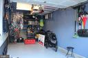 Garage with a lot of storage racks - 7009 BIRKENHEAD PL #8C, ALEXANDRIA