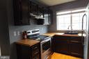 Updated stainless stove and updated cabinets - 1134 HUNTMASTER TER NE #302, LEESBURG