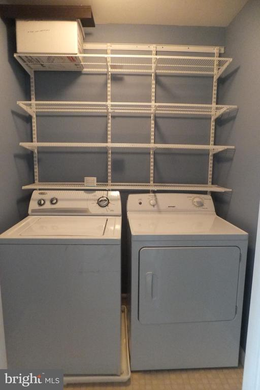 Hall laundry area with washer and dryer - 1134 HUNTMASTER TER NE #302, LEESBURG