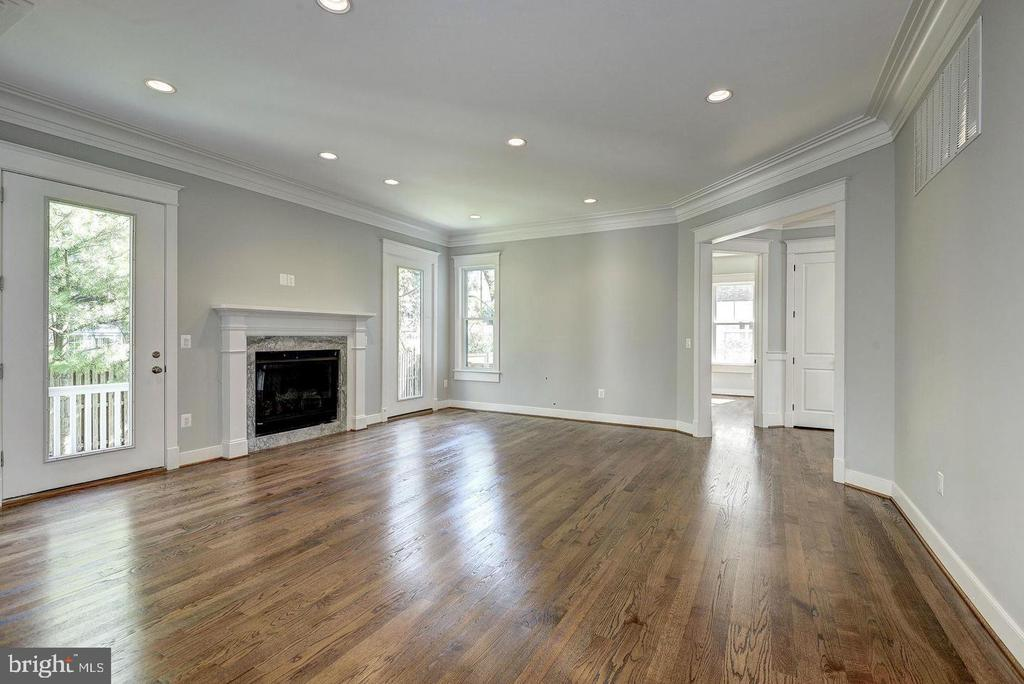 Family room with gas fireplace - 7316 REDDFIELD CT, FALLS CHURCH