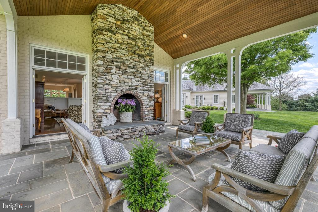 Rear covered terrace with wood burning fireplace - 2200 GADD RD, COCKEYSVILLE