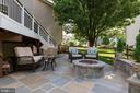 Bluestone patio with fire pit and seating wall - 21384 CLAPPERTOWN DR, ASHBURN
