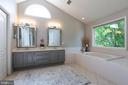 Stunning beveled mirrors and updated lighting - 21384 CLAPPERTOWN DR, ASHBURN