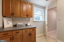 Laundry with window and cabinetry - 21384 CLAPPERTOWN DR, ASHBURN