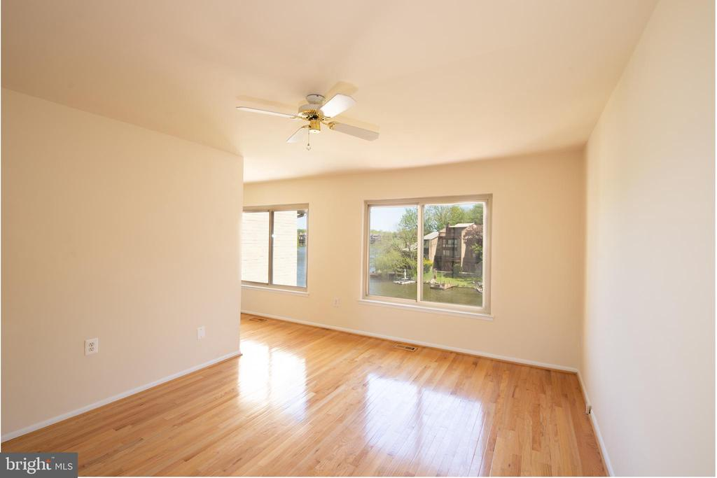 Abundant light and lake views from master bedroom - 2025 CHADDS FORD DR, RESTON