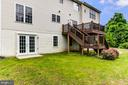 rear of house with lovely trex deck - 125 WALNUT FARMS PKWY, FREDERICKSBURG