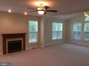 Gas fireplace in family room - 12302 HUNGERFORD MANOR CT, MONROVIA