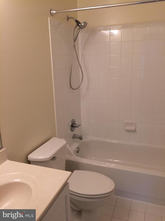 Third full bath accessible from 2nd floor hallway - 12302 HUNGERFORD MANOR CT, MONROVIA