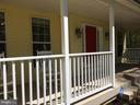 New front porch swing and rocking chairs convey! - 12302 HUNGERFORD MANOR CT, MONROVIA