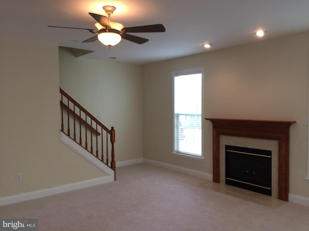 Gas fireplace and back stairs to upper level - 12302 HUNGERFORD MANOR CT, MONROVIA
