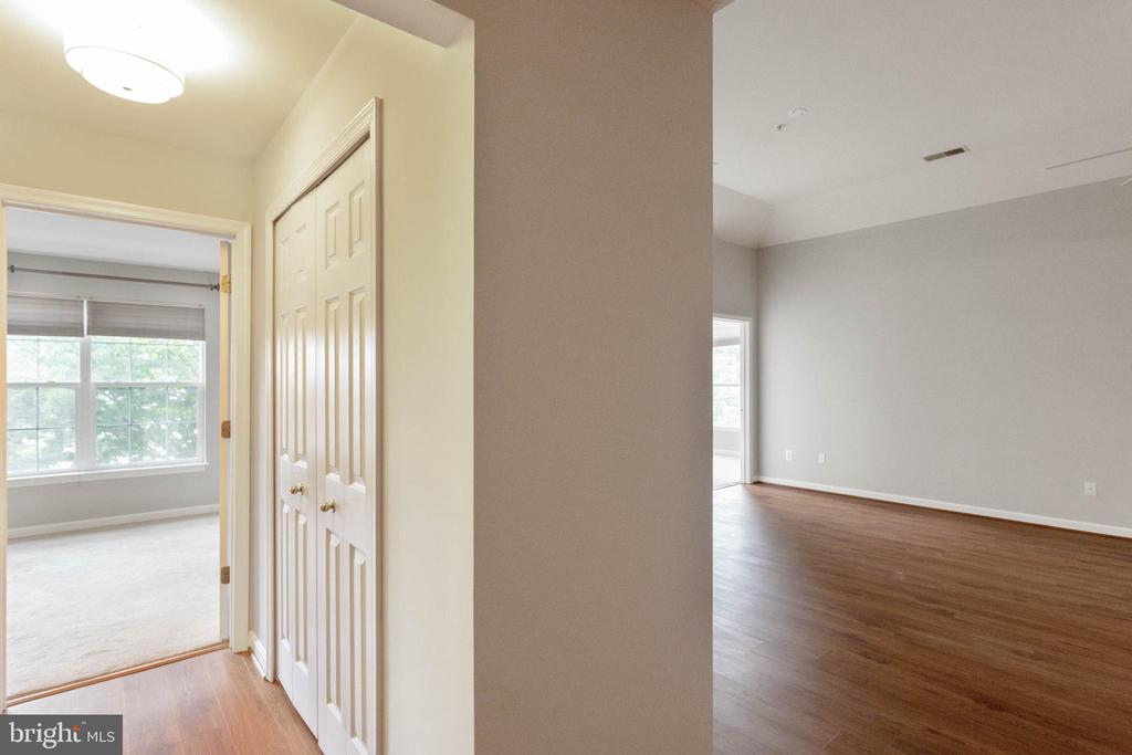HALLWAY LEADING TO LIVING ROOM AND BEDROOM - 10732 SYMPHONY WAY #202, COLUMBIA