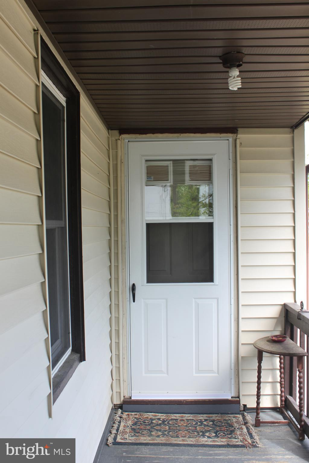 Front Entrance off of L Shaped Wrap Around Porch