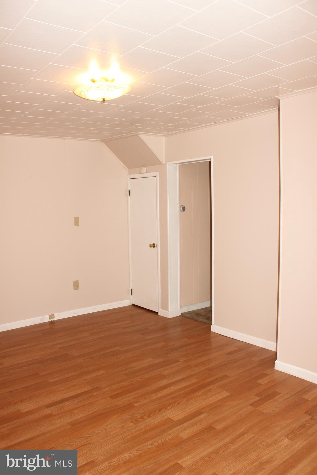 Spacious, light filled living room  with new floor