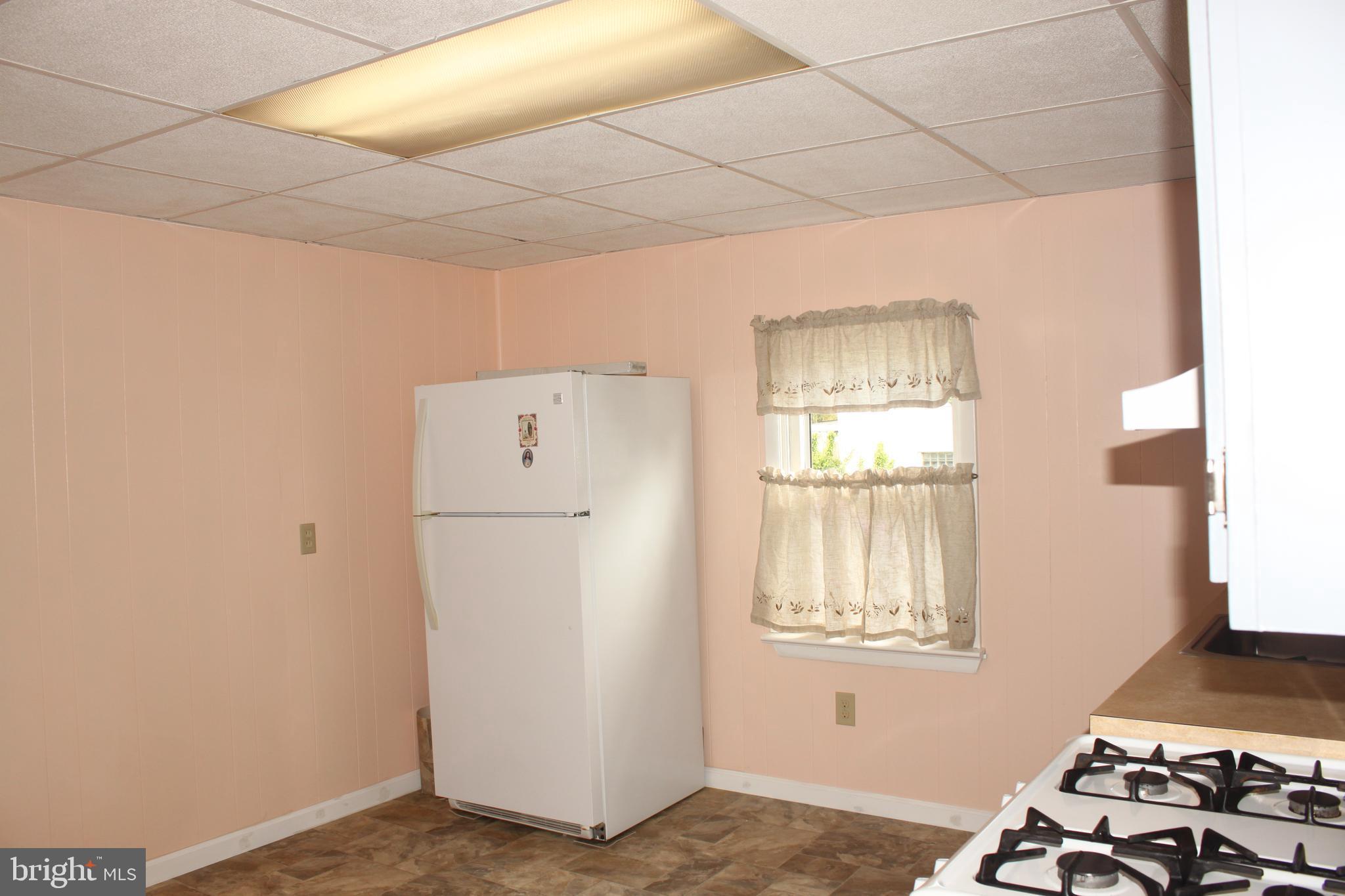 Kitchen featuring new flooring, windows, cabinets