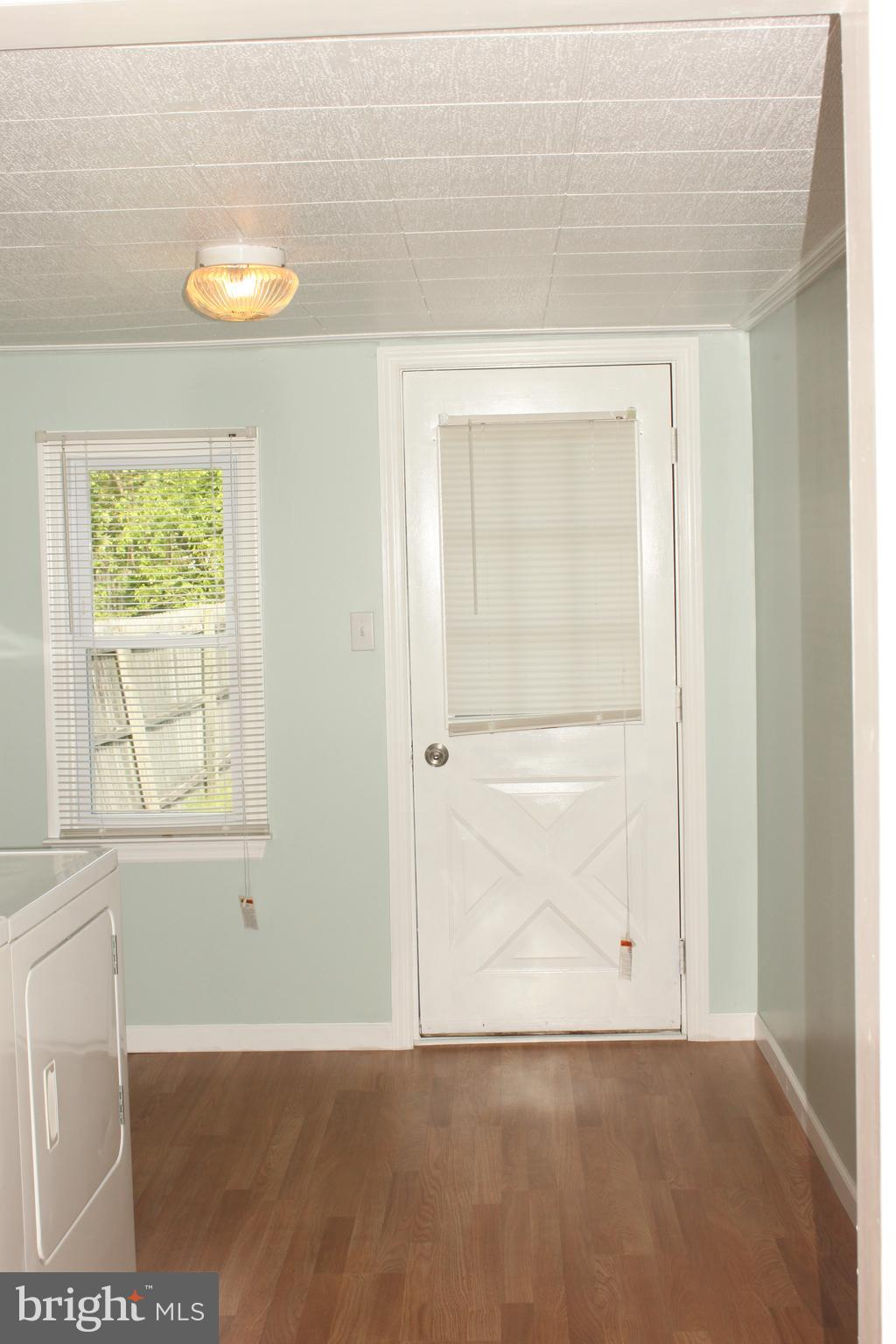 Laundry/mud room with back entrance