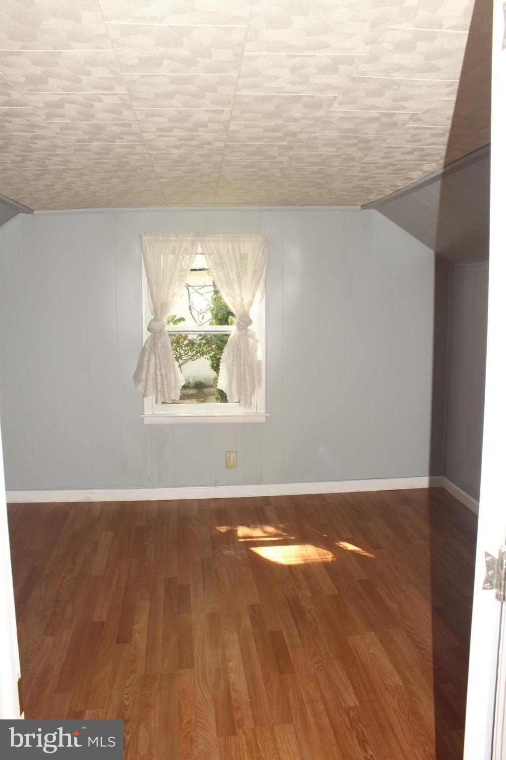 Light filled Bedroom in front of house.
