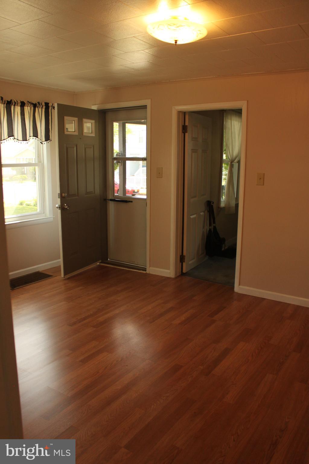 View of living room to front door
