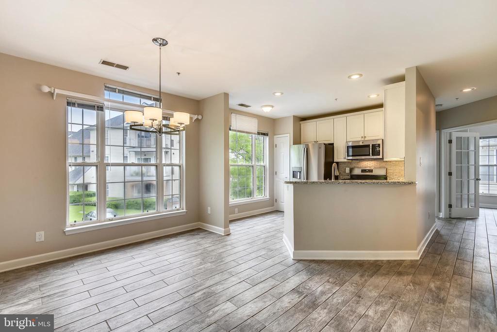 Sleek tile flooring throughout - 43114 WATERCREST SQ #205, CHANTILLY