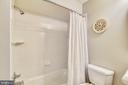 Basement full bath w/pedestal sink and tub w/tile - 732 HUNTON PL NE, LEESBURG