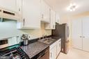 Updated kitchen with stainless steel appliances - 12705 LOTTE DR #103, WOODBRIDGE