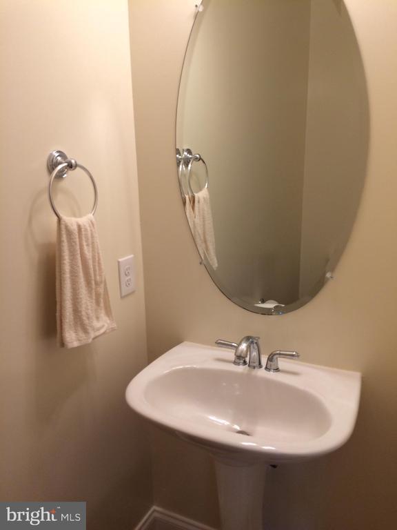 First floor half bath - 12302 HUNGERFORD MANOR CT, MONROVIA