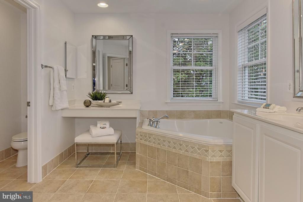 Spa Toned Tile in the Owners Bath w/ Soaking Tub - 42690 EXPLORER DR, BRAMBLETON