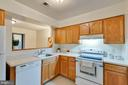 Kitchen w/pass through window to Dining - 5967 VALERIAN LN, ROCKVILLE