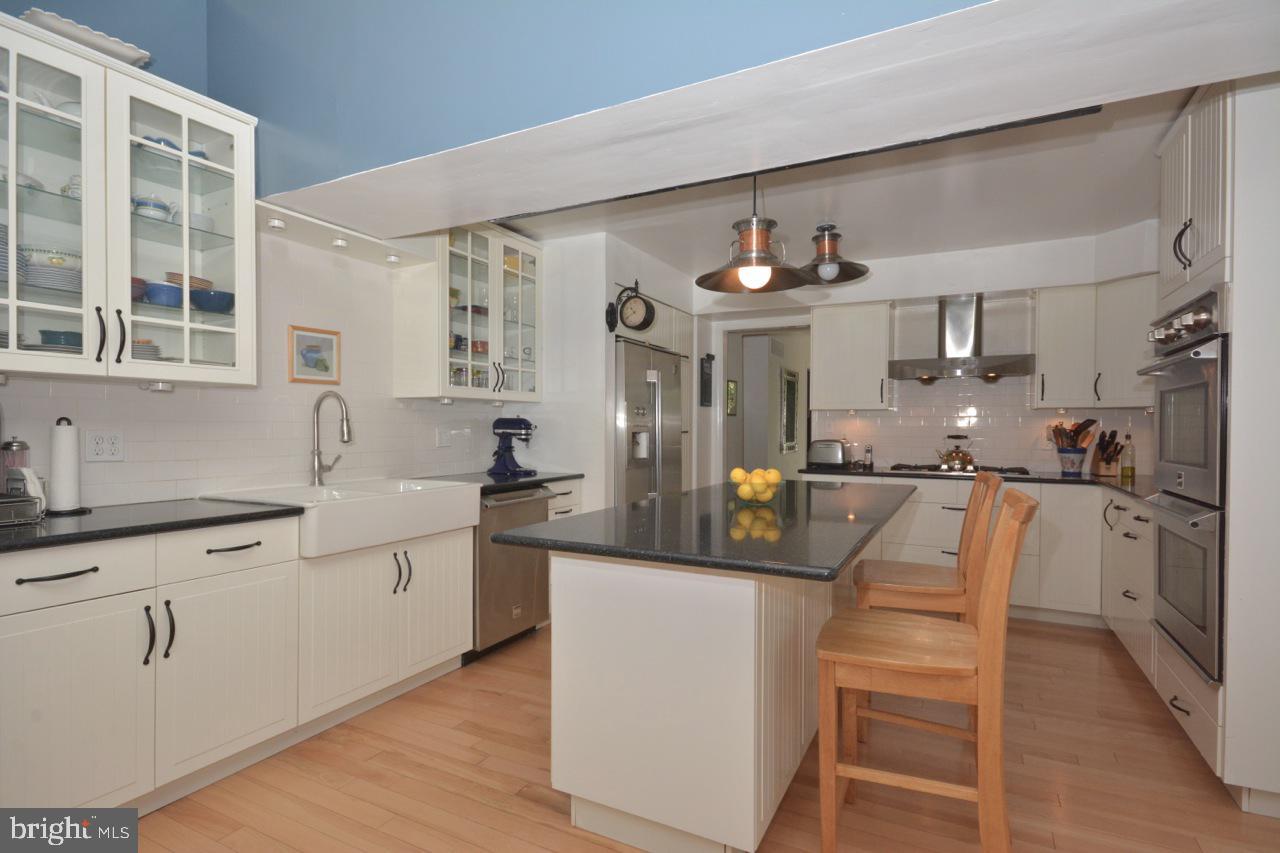 Updated kitchen- white cabinets &  granite counter