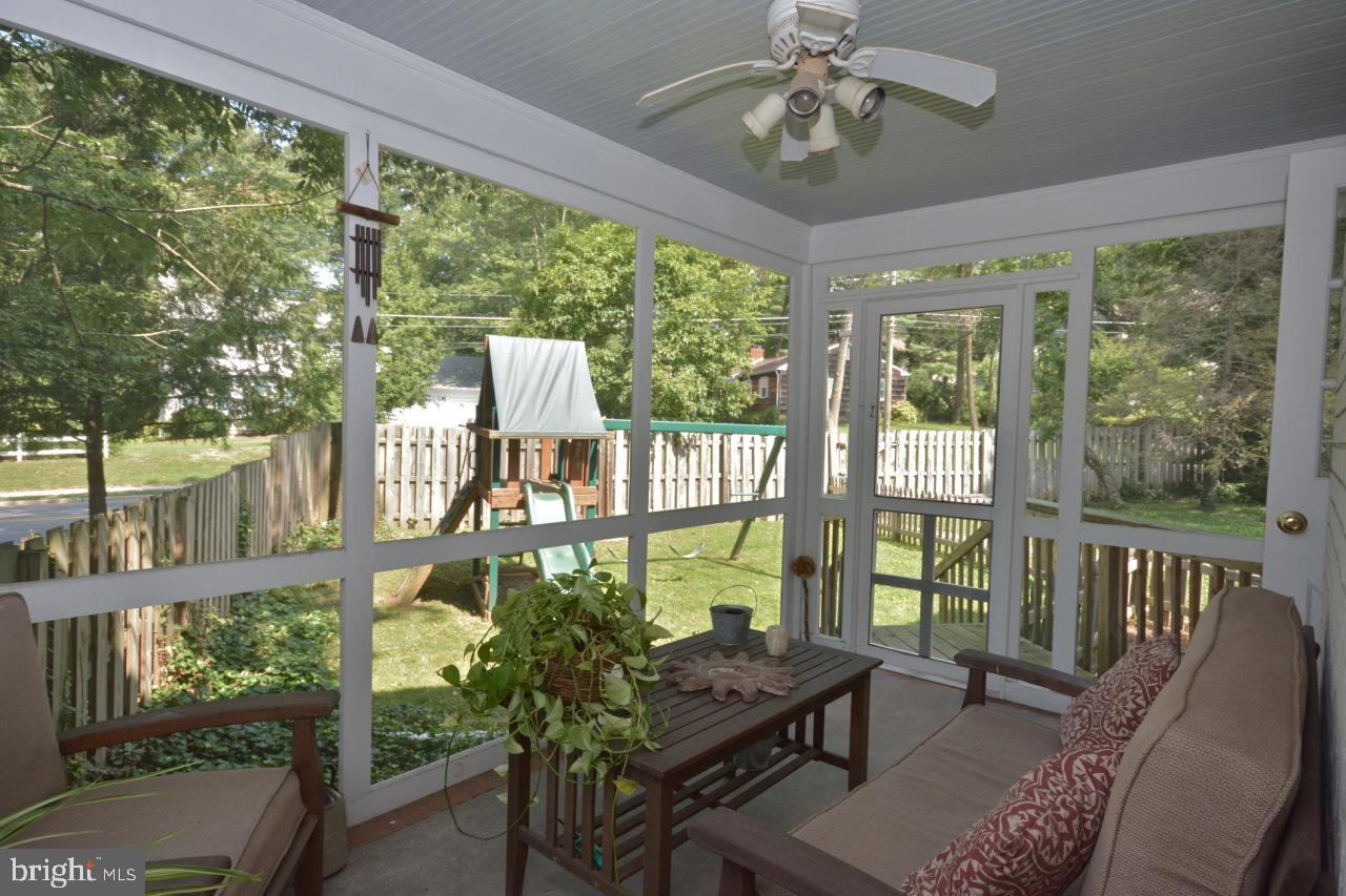 Screened-in side porch overlooking backyard.