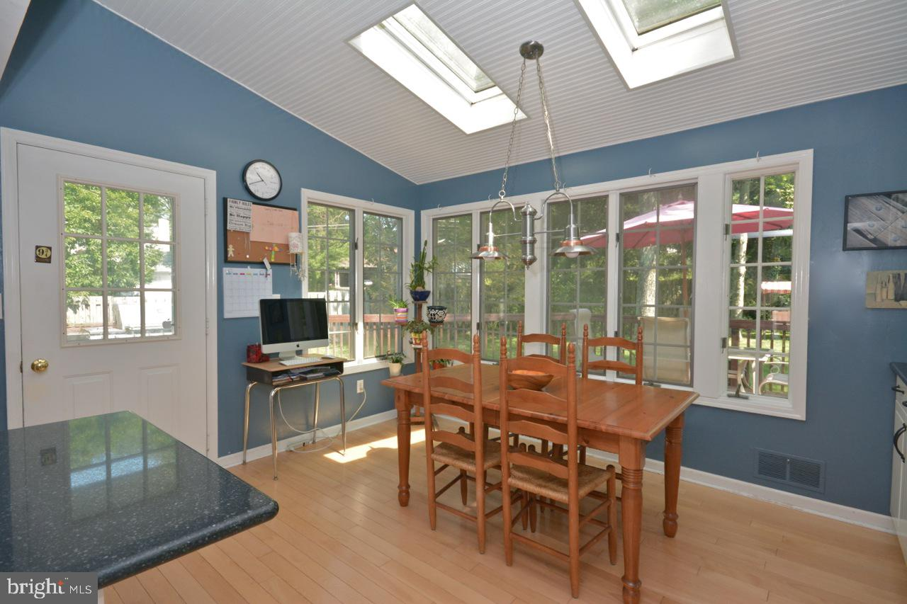 Breakfast room with dual skylights.