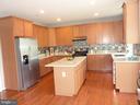 Kitchen w/ Hardwood Floor & New Granite Countertop - 5322 SAMMIE KAY LN, CENTREVILLE