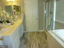 Master Bath with Glass Shower and New Floor Tiles - 5322 SAMMIE KAY LN, CENTREVILLE