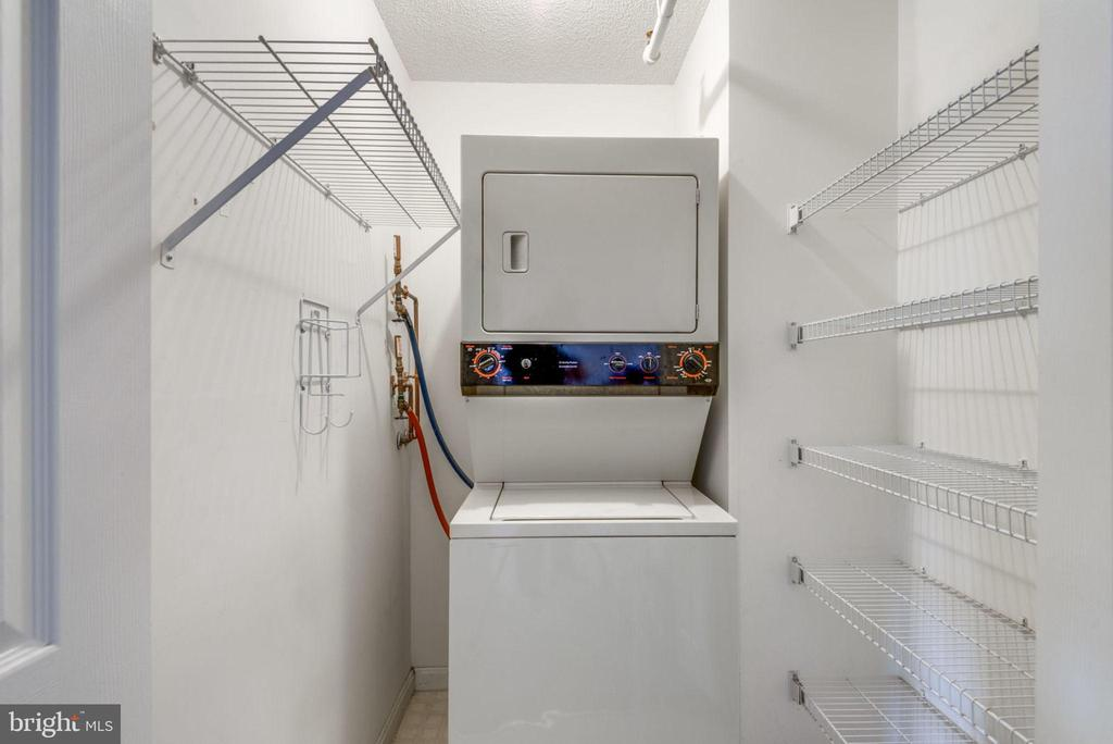 Laundry Room Has Built-in Shelving - 19385 CYPRESS RIDGE TER #715, LEESBURG