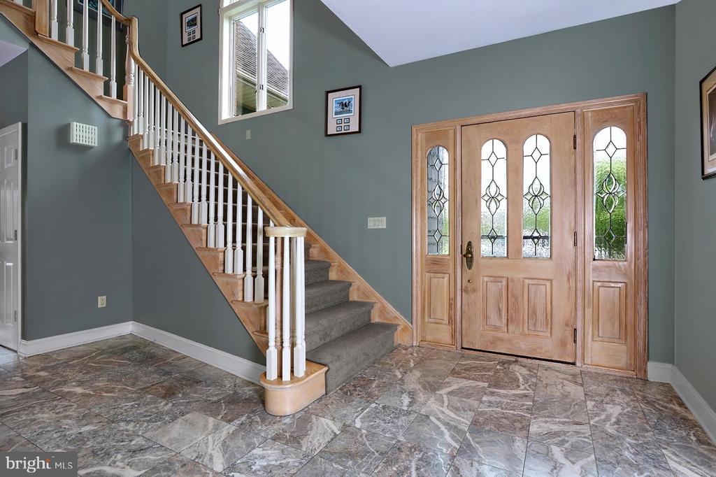 Foyer is made cozy by radiant marble floors. - 17 AQUA TER, HAMILTON