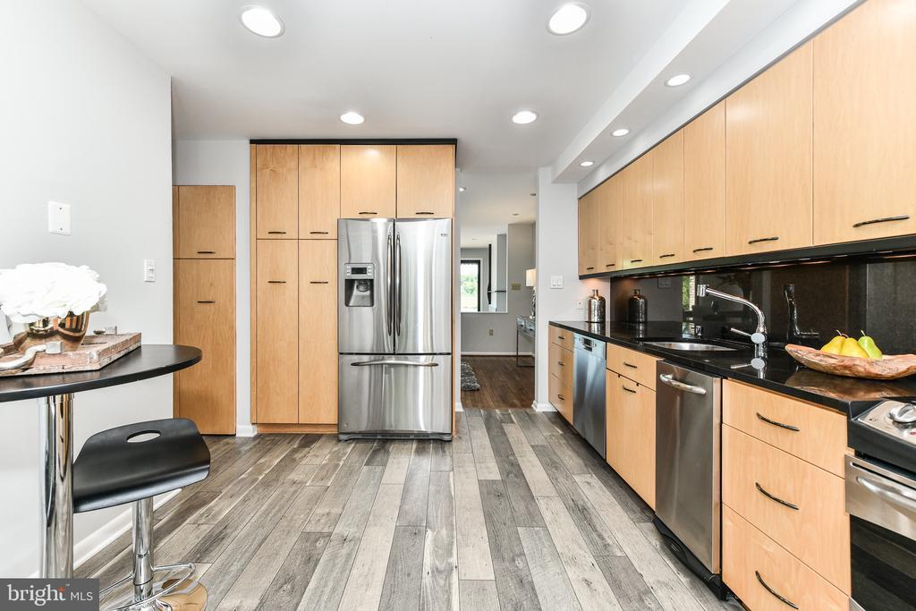 New floor meets refinished original flooring - 2011 LAKEWINDS DR, RESTON