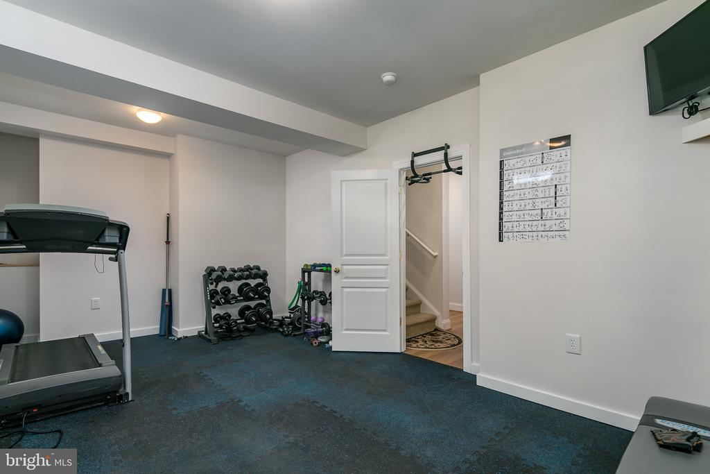 workout room with removable gym flooring - 7560 HUNTER WOODS DR, MANASSAS