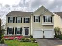 Front view of the house with flowering azaleas - 5322 SAMMIE KAY LN, CENTREVILLE