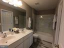 Hallway Bath with New Tiles Floor and Shower - 5322 SAMMIE KAY LN, CENTREVILLE