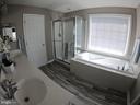 Master Bath with Bathtub and New Floor Tiles - 5322 SAMMIE KAY LN, CENTREVILLE