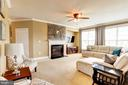 Large family room with stone above fireplace - 16800 ANCHOR BEND CIR, WOODBRIDGE