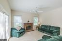 Family room opens to the deck. - 18 WESTHAMPTON CT, STAFFORD