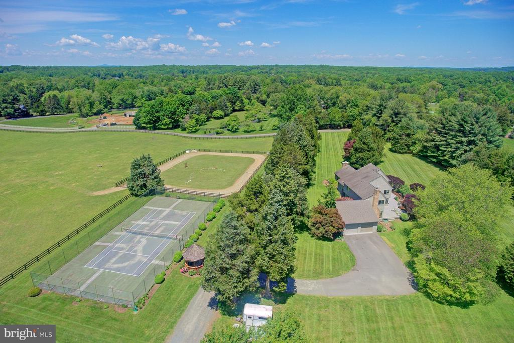 Home, tennis court, riding ring and pastures - 9421 CORNWELL FARM DR, GREAT FALLS