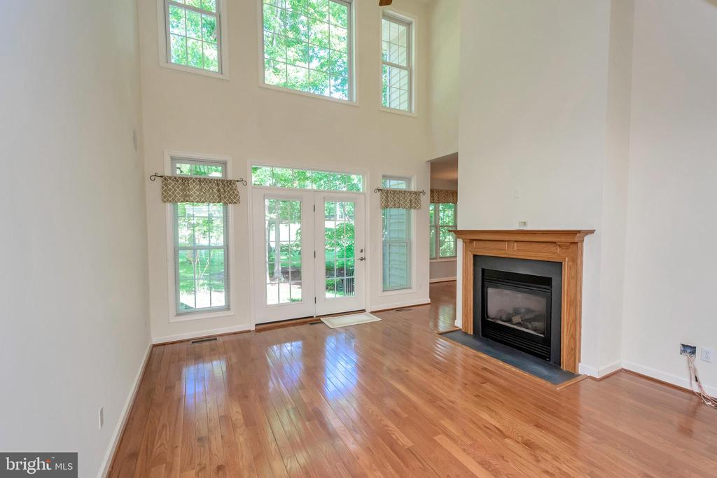 Two-story family room with gas fireplace - 430 BIRDIE RD, LOCUST GROVE